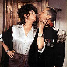 Kenny and Joan get close in Up the Khyber